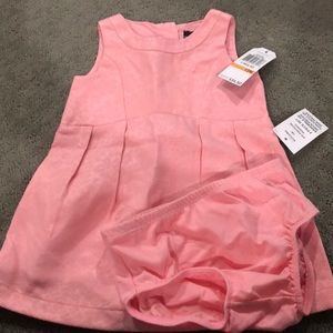 Pink sleeveless dress with bottoms
